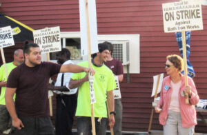 Top, SWP presidential candidates Alyson Kennedy, right, and Malcolm Jarrett, back center, join Bath, Maine, shipyard strikers on picket line July 2. Inset, congressional candidate Willie Cotton, right, marches in New York City July 4 protest.