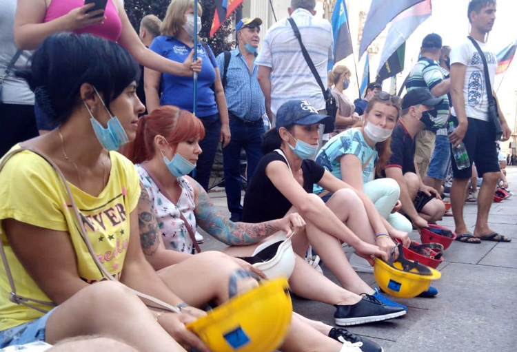 Ukranian women coal processing plant workers bang their hard hats as part of 1,000-strong miners' protest in Maidan Independence Square, Kyiv, June 30. The rally demanded government pay months, sometimes years, of wages owed, and increase investment in safety and jobs.