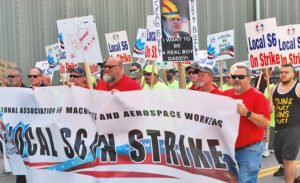 "Shipyard workers on strike in Bath, Maine, and supporters march July 25 against company demands to expand subcontracting, cut back seniority rights and raise health care costs. ""This is not about greed on our part,"" said striker John LaPointe. ""It's about dignity,"" and knitting together generations of workers."