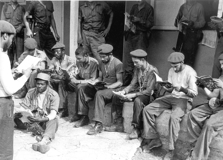 Militia members in the Escambray learning to read and write in 1961. Land reform and literacy campaign benefited peasants, helping the volunteer fighters defeat counterrevolutionary bandits, and deepened support to Cuba's socialist revolution and its leaders.