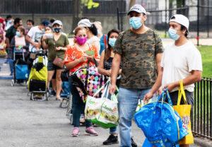 Quarter-mile-long line outside food bank in Queens, N.Y., Aug. 22, as bosses cut jobs, hours.
