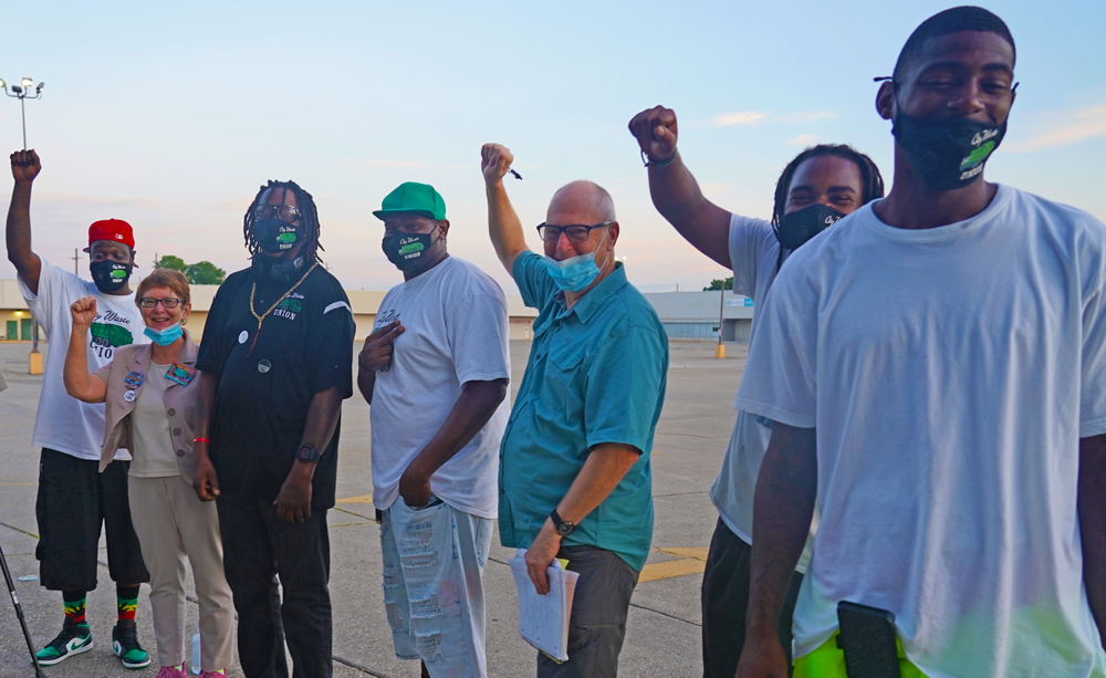 "Group of striking New Orleans sanitation workers, called ""hoppers,"" with SWP 2020 presidential candidate Alyson Kennedy, Aug. 13. After pay cut they're demanding living wage, safe working conditions."