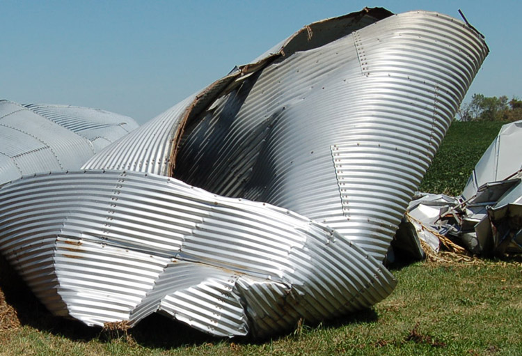 Grain silos in Linn County smashed by powerful Aug. 10 windstorm that battered Iowa. Government has left farmers, workers on their own, turning natural disaster into a social crisis.