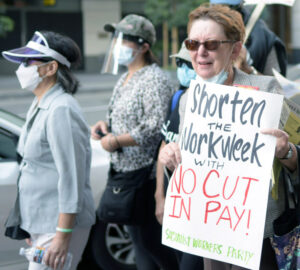 Alyson Kennedy, right, SWP candidate for president, joins Sept. 7 labor protest in San Francisco, campaigns for unions to fight for shorter workweek with no cut in pay.