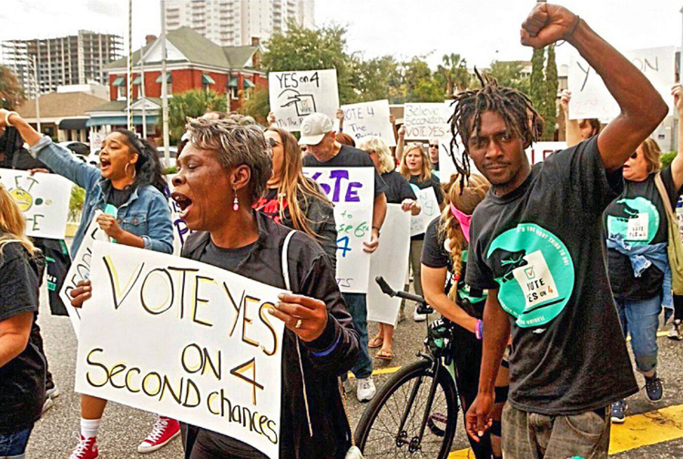Rally in Florida in October 2018 backing Amendment 4 to restore voting rights to over 1 million former prisoners. It passed by 64%. Militant covers these struggles for prisoners' rights.