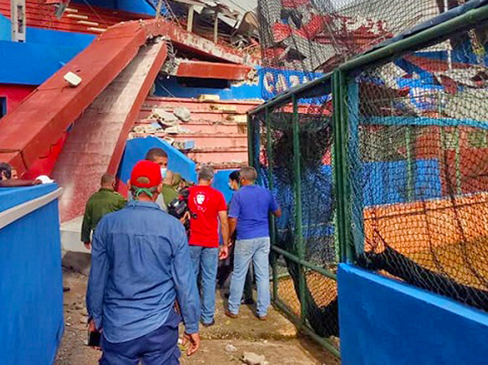 Damage at July 26 baseball stadium in Artemisa, Cuba, is inspected by local authorities after tropical storm Laura in August. Mass organizations respond immediately to impact of disasters.