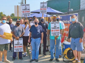 Teamsters fighting for first contract picket DSI Tunneling in Louisville, Ky., Sept. 10 with IBEW Local 369 members who brought gift cards to help strikers. Solidarity is key to building unions.