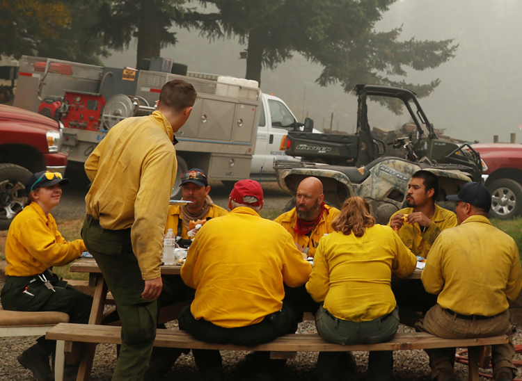 "A few of the 1,200 workers in the ""Hillbilly Brigade"" who volunteered to fight fires gather for a meal at Hansen family farm after battling the Riverside Fire near Molalla, Oregon, Sept. 16."