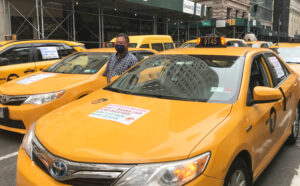 NYC taxi drivers demand 'Debt forgiveness NOW!'