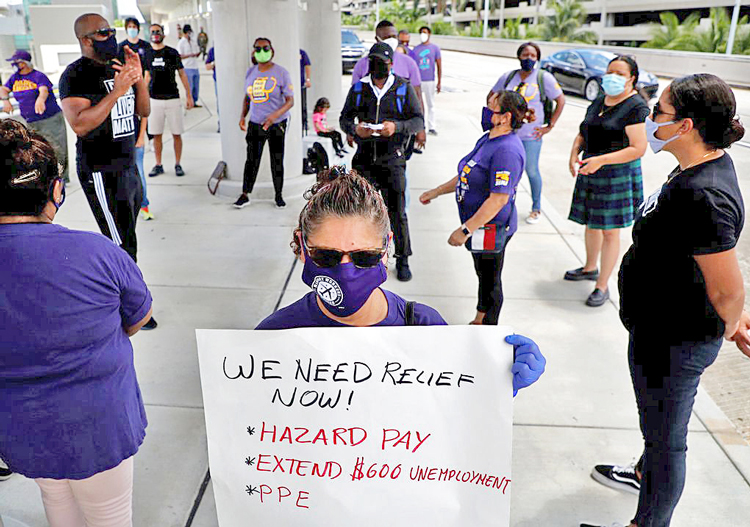 SEIU 32BJ union members demand jobs back, safe conditions, unemployment pay Aug. 13, after Delta airlines contractor Eulen America laid off 100 workers at Ft. Lauderdale airport.