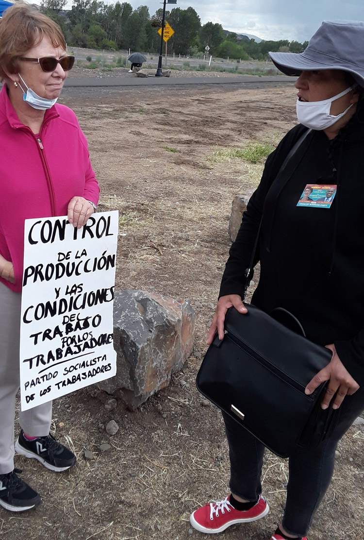 Alyson Kennedy, left, SWP presidential candidate, talking with striker Angie Lara on Allan Brothers fruit packers picket line in Naches, Wash., May 19. Lara is member of Trabajadores Unidos por la Justicia.