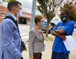 SWP candidate for president Alyson Kennedy, and Samir Hazboun, left, party's candidate for Congress in Kentucky's 3rd District, talk with worker at JBS packing plant in Louisville Oct. 23.