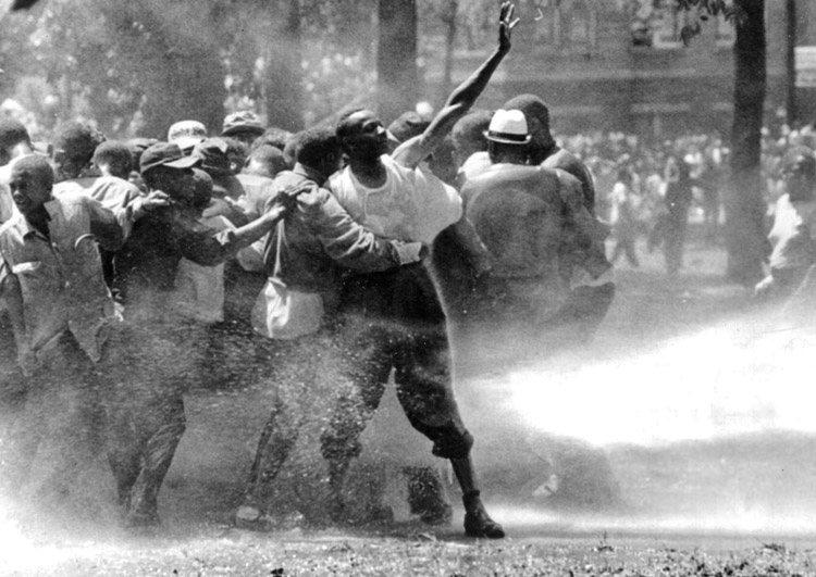 Civil rights protest attacked by cops in Birmingham, Alabama, 1963. Mass Black-led movement ended Jim Crow, advancing consciousness in whole working class against racism.
