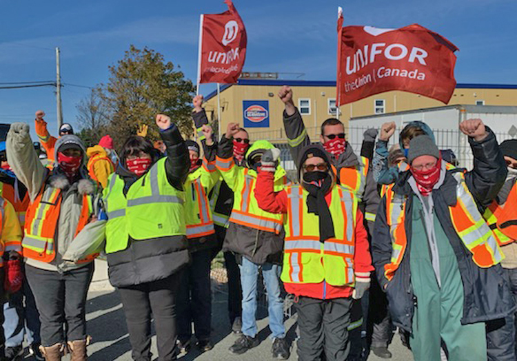 """Dominion workers picket Oct. 26 at Weston's bakery in St. John's, Newfoundland. """"See us, hear us, because we're not going anywhere,"""" said Unifor Local 597 President Carolyn Wrice."""