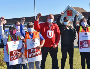 Grocery store workers, members of Unifor Local 597, picket Dominion store in Newfoundland, Canada. Some 1,400 have been on strike over past month against wage cut, for full-time work.