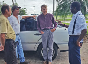 From left, retired farmers John and Robert St. Martin, and farmer Karl Butts discuss crisis facing working farmers with SWP vice presidential candidate Malcolm Jarrett and presidential candidate Alyson Kennedy, who took the picture, in Plant City, Florida, Sept. 28.