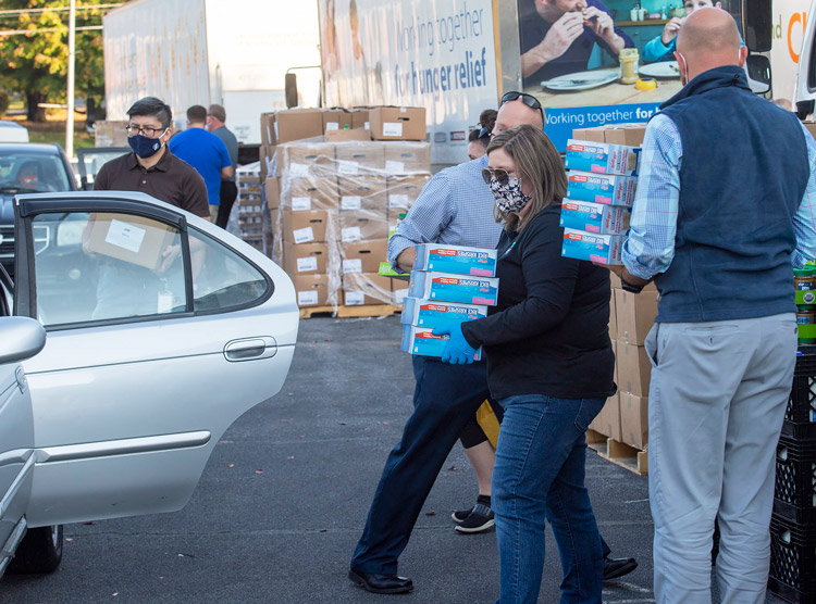 Pop-up distribution center gives out food at Virginia High School, Bristol, Virginia, Oct. 15. Growing numbers depend on events like this in face of rising joblessness. Neither Joe Biden nor Donald Trump propose to get millions thrown out of work back into jobs immediately.