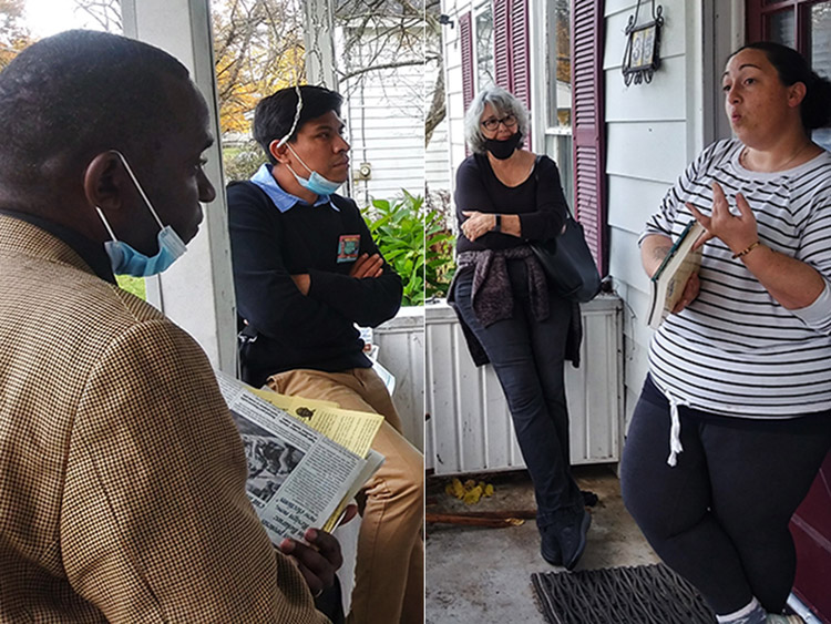 Vice presidential candidate Malcolm Jarrett, left, speaks with Amanda Mazza, right, on her doorstep in Gloversville, New York, Oct. 21.