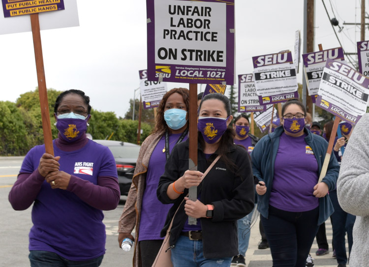 Health care workers picket in front of Fairmont Wellness Center in San Leandro, California, Oct. 8 during five-day strike at six public hospitals for safety for patients and themselves.