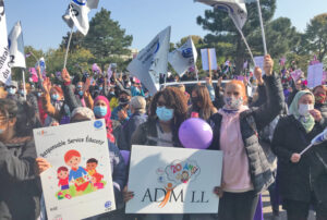 Day care workers rally at Quebec Families Ministry Sept. 21 in support of 10,000 at-home day care workers on province-wide rotating strikes since Sept. 1 for better pay, conditions.