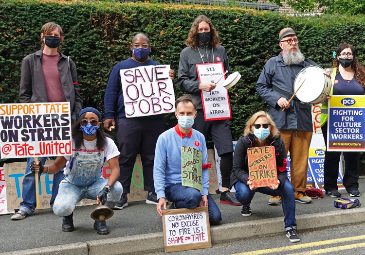 """Striking bookstore, cafeteria workers at Tate and Tate Modern Galleries in London, Aug. 28, protest bosses' plans to cut 313 of their jobs. Claiming to end nonexistent """"zombie jobs,"""" U.K. gov't is dumping burden of shutdowns onto millions of workers to fend for themselves."""