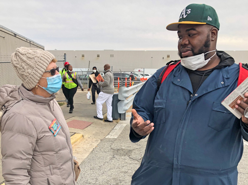 "Alyson Kennedy, SWP 2020 presidential candidate, talks with Shawn Washington at Ford Motor plant gate Oct. 28 in Chicago, about why workers need to break with voting for Democrats or Republicans as the ""lesser evil."" ""You're damned if you do, and damned if you don't,"" he said."