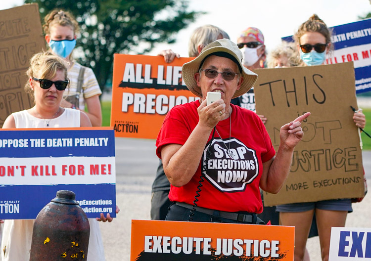 Protest at Indiana federal prison Aug. 26 against execution of a Native American, Lezmond Mitchell, opposed by Navajo Nation leaders. U.S. executions are among highest in the world.