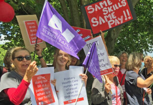 Primary care workers in New Zealand Nurses Organization rally in Auckland Nov. 9 as part of 24-hour strike backing equal pay with nursing counterparts in public hospitals nationwide.