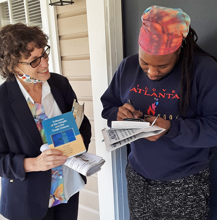 """""""Workers control of production. I love that!"""" David Wilkerson, right, told SWP U.S. Senate candidate Rachele Fruit Nov. 21 in Dallas, Georgia, after reading party's action program. He subscribed to Militant, got two books."""