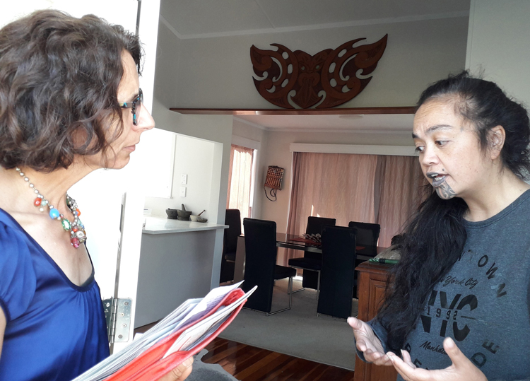 Annalucia Vermunt, left, one of Communist League's two candidates in October parliamentary elections in New Zealand, campaigns on workers' doorsteps in Northcote.