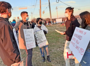 "Dec. 10 protest outside federal prison in Terre Haute, Indiana, where U.S. gov't carries out executions. Socialist Workers Party member Samir Hazboun, second from left, talks with Indiana University students. ""Use of death penalty is a bipartisan attack on the working class,"" he said."