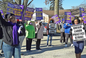 Nov. 28 strike picket line at nursing home in Momence, Illinois, one of 11 owned by Infinity Healthcare. Issues include pay and serious understaffing endangering both workers and patients.
