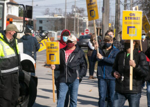 Workers at Owens Corning in Guelph, Ontario, on strike Nov. 20 against concession demands, an example of workers fighting boss attacks on jobs, wages, health and working conditions.