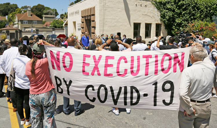 Rally near San Quentin State Prison in California July 9, where 20 inmates who tested positive for COVID-19 spoke out against conditions. Over 2,200 inmates were infected and 28 died.