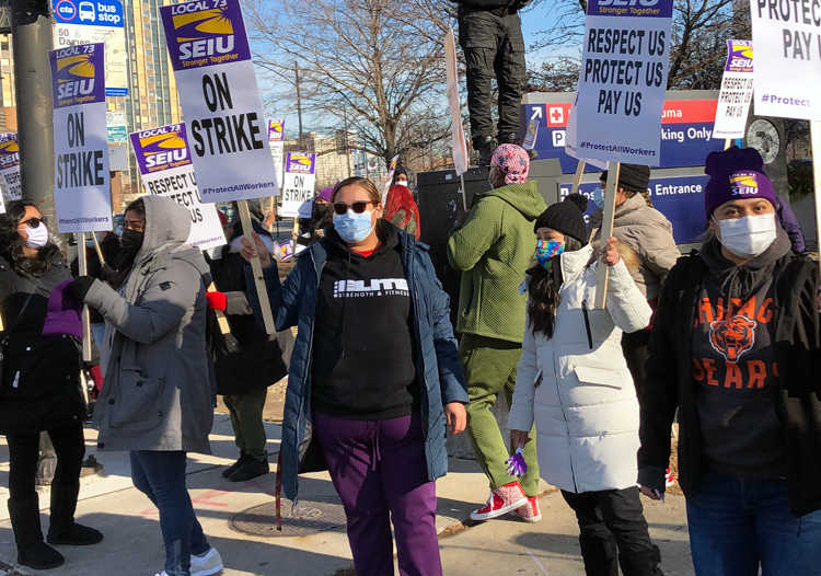 Health care workers at Stroger hospital in Chicago during one-day strike by 1,500 workers at Cook County facilities Dec. 22. Nurses, health workers have gone on strike across the country.