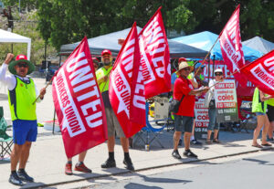 Locked-out United Workers Union members picket Coles distribution center in Sydney, Australia, Nov. 20, in fight for pay raise, severance pay in warehouse closing, jobs at new facility.