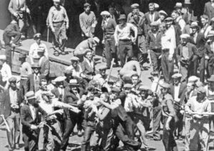 In May 1934 Minneapolis Teamsters rout cops, special deputies from bosses' Citizens Alliance that were sent to break their strike. Class-conscious leaders organized workers defense to win.