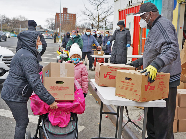 Volunteers at food pantry in Brooklyn in December distribute boxes of groceries to working families hit hard by prolonged unemployment. Jan. 6 disruption in Washington did not alter anything for working people as social, economic and moral crisis of capitalism continues.
