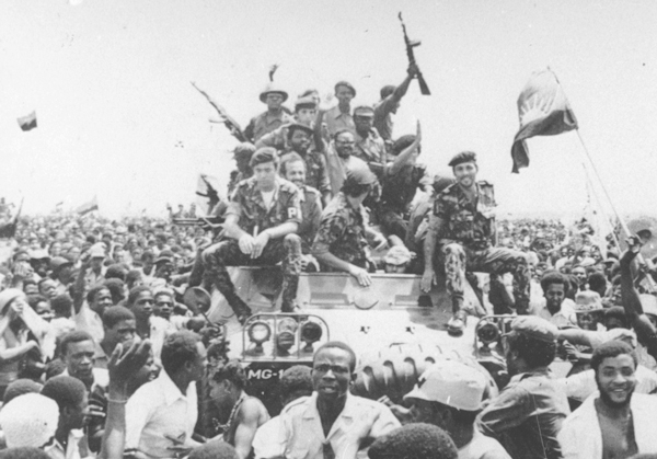 Cuba's victorious volunteer internationalist forces, above, join newly independent Angolans to celebrate in 1975. For 15 years, Cuban, Angolan and Namibian fighters battled to defeat U.S.-backed South African invasions. Gerardo
