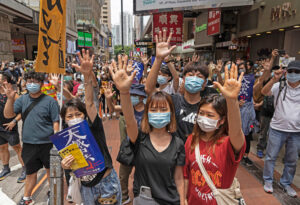 Marchers in Hong Kong May 24, 2020, protest Beijing's moves to impose national security law that restricts protests, free speech and tightens Chinese government control over territory.