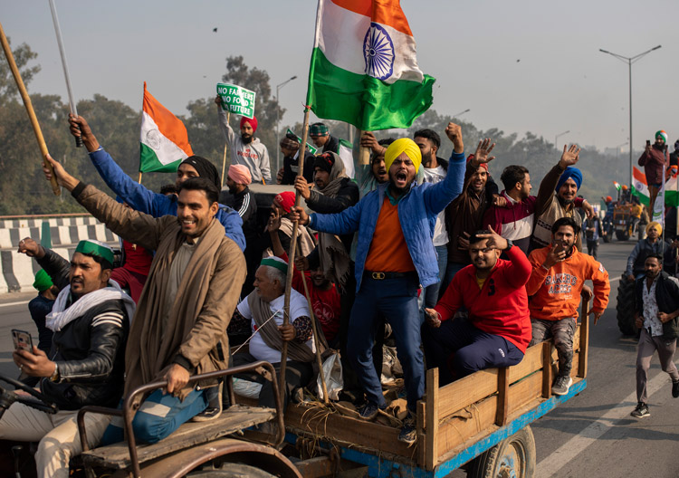 """Farmers' tractor convoys converge on New Delhi, India, Jan. 26, demanding repeal of farm """"reform"""" bill that would eliminate price supports and drive family farmers off the land."""