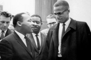 "Washington used the FBI, the capitalist rulers' political police, to spy on and try to disrupt the Black liberation movement, including targeting both Malcom X, right, and Martin Luther King Jr., left. Democrats claim greater police powers are needed to counter ""domestic terrorism."""