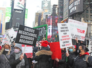 Laid off Marriott Marquis hotel workers in New York protest in Times Square Dec. 23 over cut in severance pay and bosses refusal to commit to bring them back if hotel reopens.
