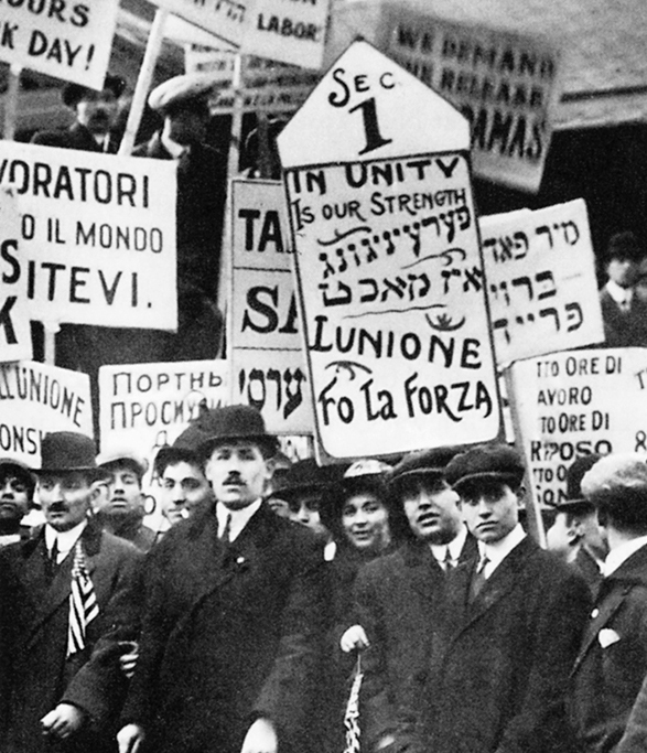 Striking textile workers picket in New York City in 1913 carrying signs in Yiddish, Italian, Russian and English.