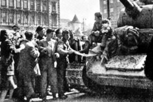 People in Zagreb, Croatia, greet liberation by Yugoslav partisans in 1945. Yugoslav Revolution forged unity of workers, peasants across ethnic and religious lines, defeating Nazi German occupation. This marked the initial years of the united workers state forged in Yugoslavia.