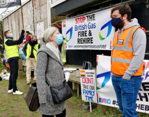 George McDonald, striking British Gas worker, talks with Pamela Holmes, Communist League candidate for London Assembly, on picket line in Sidcup, North Kent, England, Feb. 22.