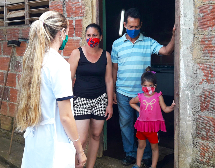 Medical worker visits family in Pinar del Río in Cuba this month. Volunteers have been mobilized during COVID pandemic to knock on thousands of doors to see if help is needed.