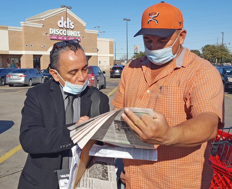 """Gerardo Sánchez, Socialist Workers Party candidate for Dallas City Council, left, talks to Arnulfo Alvarez Jan. 25. """"SWP campaign fights for amnesty for all 11 million undocumented immigrants who live and work in the U.S.,"""" Sánchez said in a statement Feb. 15."""