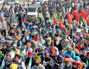 "Farmers block Jalandhar-New Delhi National Highway during ""chakka jam"" protest Feb. 6 against new government laws ending state-backed minimum prices guaranteed to farmers."