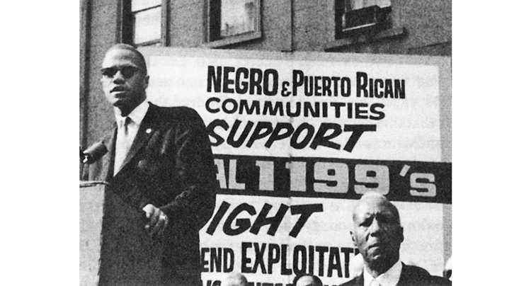 Malcolm X speaking at July 1962 New York rally called to support fight for union recognition by Local 1199. Malcolm praised Leon Davis, SEIU Local 1199 president, who spent 30 days in jail rather than comply with court order to call off 56-day strike by hospital workers.
